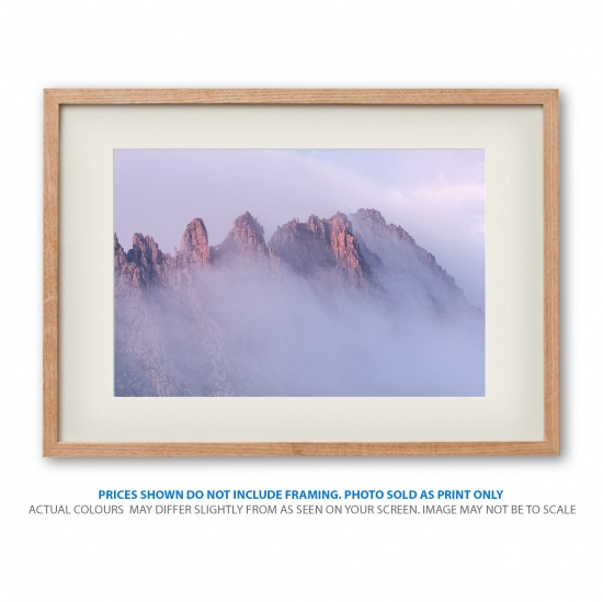 Soaring peaks of the Cradle Mountain at sunrise photo shown in frame